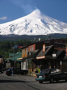 Villarrica, Chile. Villarrica is one of Chile's most active volcanoes, rising above the lake and town of the same name, 750 km south of Santiago. It is also known as Rucapillán, a Mapuche word meaning House of the Pillán or House of the spirit. (V)