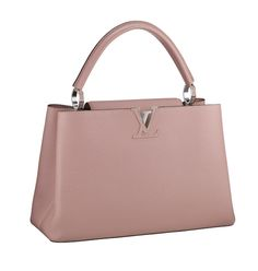Accessory interpretation: This is a novelty Louis Vuitton bag. This is one of the key items to have when looking at the soft pop trend. It is a simple, structured and classy bag that is meant to fit the trend in a subtle way. The main focus in the trend is the overwhelming clothing, which explains the simplicity of the accessory. Although it isn't extravagant, less is always more and it is a perfect way to complement a distinctive trend.