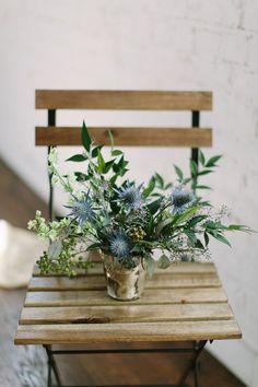thistle floral arrangement, photo by Anne Brookshire http://ruffledblog.com/slate-gray-wedding-inspiration #flowers #centerpieces