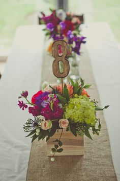 Love these table numbers...and the centerpiece they are in!