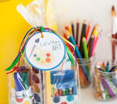 Art Tag - Let's make some art! I made these favor bags for an art themed birthday party. Included are all the supplies to make mini masterpieces - watercolors, crayons, paper, and markers. I tied it all up with rainbow ribbons and this Print Then Cut tag. #DIY Printables CricutMade