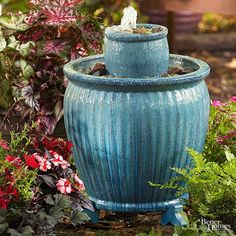 15 easy DIY garden accents that will give your outdoor space a personalized spin. Double-Decker Fountain (slide 10 of Diy Fountain, Garden Fountains, Tabletop Fountain, Water Fountains, Outdoor Fountains, Garden Ponds, Koi Ponds, Easy Garden, Lawn And Garden