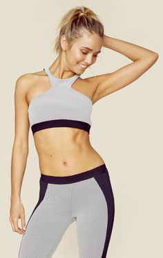 """The Jacquard Sportsbra features a high neck silhouette, multi strap detailing in the back, and a super stretch fabrication providing maximum support. Pair with the Jacquard Leggings to complete your sporty style!Made in USAHand Wash Cold92% Polyamide 8% ElastinFit Guide:Model is 5ft 9 inches; Bust: 34"""", Waist: 24"""", Hips: 34""""Model is wearing a size XSStretch FitShoes Featured Not Available For Purchase"""