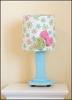 fabric roses on lampshade - great idea to make the plain white lamps for Janna's room super cute
