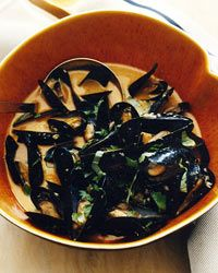 """Curried Mussels in White Ale Recipe on Food & Wine """"I first made these mussels for Thanksgiving two years ago,"""" says Sang Yoon. """"I don't make a traditional Thanksgiving dinner—I cook outside the box and call it Sangsgiving ABT (Anything But Turkey). The mussels were such a hit, I put them on the menu at Father's Office."""" Adding creamy white ale to the intense curry broth helps mellow the flavors."""