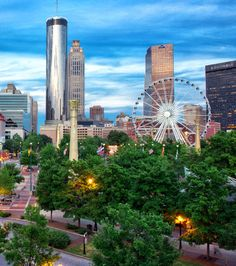 A view of downtown Atlanta - with a portion of Centennial Olympic Park and the SkyView Wheel.