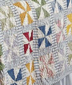 pinwheel quilt with stripes in the sashings