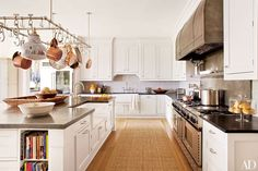 Both functional and sophisticated, pot racks add irresistible charm to these stylish kitchens
