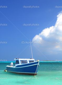 Fisherman's boat in a tranquil bay outside of Oranjestad Aruba of the Netherlands #Caribbean