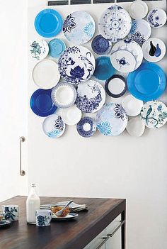 Great variety in a monochromatic color scheme for wall decor. Perfect for a dining room!  | plates | wall art |  How-To: Decorate on the Cheap with Pretty Plates from casasugar