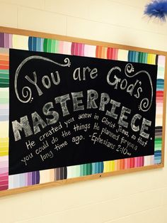 I used paint chips from the hardware store as a border on top of black bulletin board paper. I hand-lettered the verse using a chalk own! People have to look very closely to realize it's not a real chalkboard.