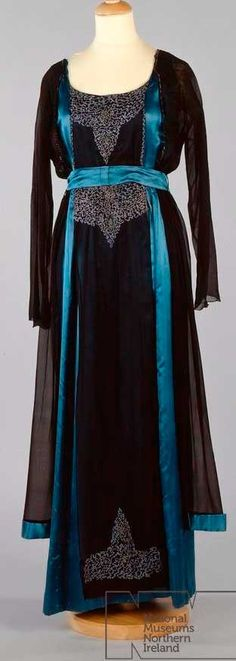 Evening dress, no date given. Embroidered black crepe over mide blue satin. Ulster Museum