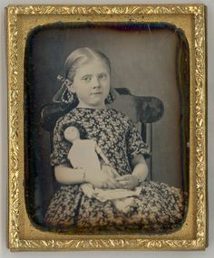 1/9th Plate daguerreotype of a sweet little girl holding her doll