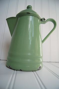 In a beautiful antique green, this enamelware coffee pot has such pretty color! Fill with fresh garden flowers for a wonderful shabby arrangement! [SOLD]