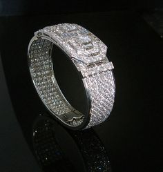 Superb cuff mounted in Platinum, the whole pave set with brilliant cut diamonds and having detachable clip. Est. weight 35carats plus two la...