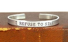 I Refuse to Sink   Affirmations  Aluminum Cuff by fromtheinternet, $13.00