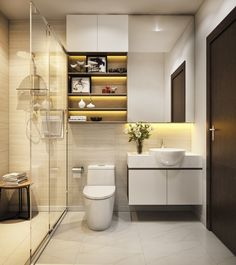 This compact bathroom seems spacious with the use of glass and light tiled flooring and textured walls. The sink seems to be sitting in the marble countertop. A lighted cabinet above gives space for display or storage. Washroom Design, Toilet Design, Modern Bathroom Design, Bathroom Interior Design, Large Bathrooms, Amazing Bathrooms, Small Bathroom, Compact Bathroom, White Bathrooms