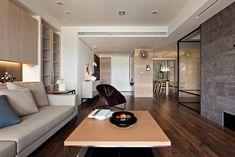 Living room arredato con il parquet scuro