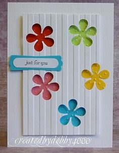 negative die cuts,,nice... by cheri..backing uses brightly colored flowers cut from by the same die...