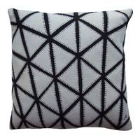Inspired by the beautiful glass ceiling of the Great Court at the British museum in London, this striking geometric cushion is embroidered with a grid of triangular patches to produce another iconic design.