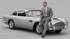 Daniel Craig and the iconic Aston Martin DB5 that was destroyed in Skyfall