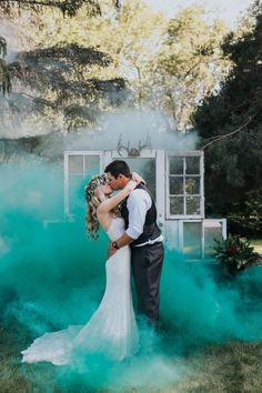 Can a wedding get any more whimsical than puffs of colorful smoke swirling around the lovebirds?
