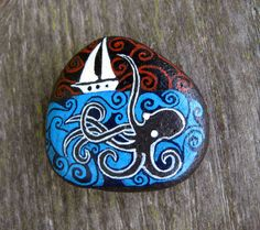 Octopus attacking sail boat hand painted beach pebble by psandker, $13.95 etsy