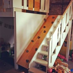 to take the stairs or rockwall? awesome kid's playroom idea!