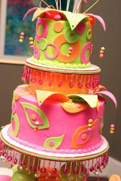 Funky, psychedelic three tier pink, orange & green wedding cake