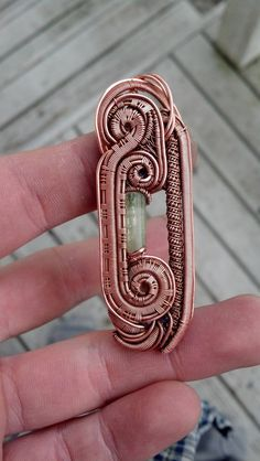 Handmade pendant with watermelon tourmaline, amethysts, and spessartine garnets, wire wrapped