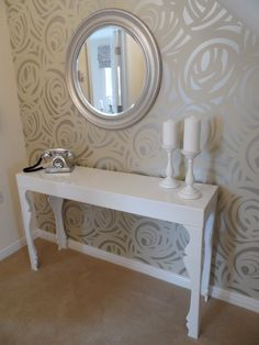 Our Show Home at Cae Nant elegant hallway featuring Harlequin fabrics Momentum collection silver Vortex wallpaper and feature mirror