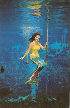 "Vintage Weeki Wachee, Florida ""Underwater Circus"" mermaid on her trapeze."