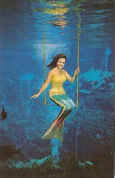 "Vintage Weeki Wachee, Florida ""Underwater Circus"" mermaid on her trapeze."