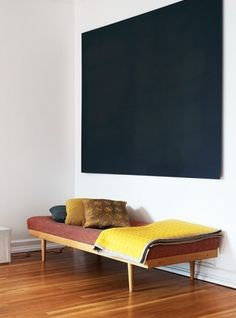 light sofa with nice textiles combined with matte black painting