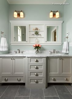 Like the medicine cabinets with a shelf in between. The cabinet color is nice, too.