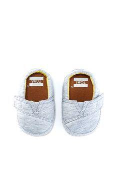 6f6bedb2ce Crib shoes with a big impact. Click to shop TOMS Crib Shoes that give back.