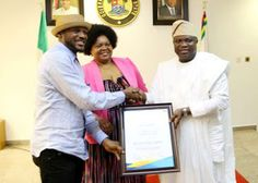 Nigerian music living Legend, 2face Idibia was honoured by Lagos State Governor, Akinwunmi Ambode, on behalf of the AFRIMA (All Africa Music Award), yesterday. The singer alongside delegates of AFR…