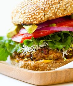 Spicy Vegan Chili Burgers. Everything you love about chili - wrapped up into a thick, bold, veg-topped veggie burger! #vegan