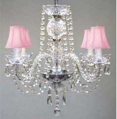 A baby girl's pink chandelier with shades covered in ruffles and bows, beaded with crystals and beads are a popular choice of moms whose dream is the most feminine, girly girl nursery that she can afford.         Go Here to See More      A beaded, pink crystal chandelier is well within reach for most decorators with many selections