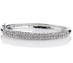 Bangle Bracelet with hinge clasp  End-to-end cut crystal pavé makes this elegant bangle bracelet a jewelry box favorite season after season. Available in silver with clear crystals and hematite
