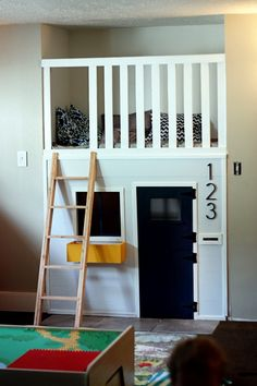 Appealing Indoor Playhouse Mezzanine Below Bed With Black Door And Window And Wooden Ladder - Use J/K to navigate to previous and next images