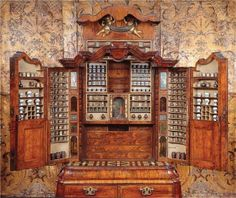Apothecary's Cabinet, 1730, Delft. Veneered with walnut and olive wood in oak core. Contents complete. The small central alcove can be removed to reveal a hidden pulley system that opens a set of secret drawers.