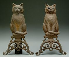 Cat Andirons. Cast Iron. Circa 19th Century.I love these.The firelight shining through the eyes would be beautiful.