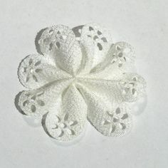 """White 2"""" hollow eyelet petal flowers. For headband making, barefoot baby sandals, sewing. Fold over elastic, rhinestones, appliqués & more also available."""