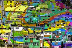 """San Sebastián de Palmitas, or simply 'Palmitas' as it is better known, is one of the 5 'corregimientos' (divisions of the rural area) of the municipality of Medellín, Mexico. The hillside town has been transformed into one giant, mind-blowing mural by a group of artists known as """"The Germ Collective"""".  