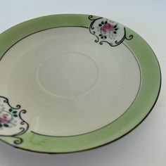 Wow picks! Chikaramachi Saucer green and white Japan saucer, vintage saucer at $21.00 Choose your wows. 🐕 #VintageSaucer #TeacupAndSaucer #VintagePlate #TeacupSaucer #ChikaramachiSaucer #ArtDecoSaucer #CollectiblePlate #MadeInJapan #AntiquePlate #1930sSaucer Etsy Vintage, Vintage Shops, Vintage Items, Antique Plates, Vintage Plates, Star Wars Light Saber, Tea Cup Saucer, Home Decor Items, Bone China