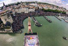 """Romina Amato calls this shot """"2 feet up then 90 feet down,"""" and continues, """"Steven LoBue of the USA launches an armstand dive from the 27.5 meter platform on the Saint Nicolas Tower during the first stop of the Red Bull Cliff Diving World Series in La Rochelle, France in front of 70,000 spectators."""""""