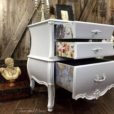 Beautiful curvy nightstand makeover in shades of gray and white with French print drawer decor.  A shabby chic dream!