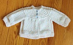 Free knitting pattern for a 5 hour baby sweater. Includes a simple adaptation to make it in a newborn size too!