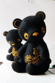 Black bears with gold embroidery